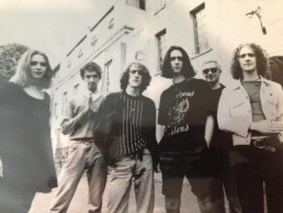 early band photo original line up outside a building