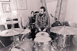 Graham Hopkins at the kit in rehearsal