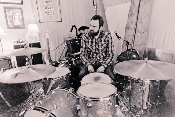 Graham Hopkins at the kit in rehearsal
