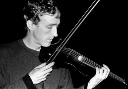 Colm plays violin at Poprad, Slovakia - July 2001
