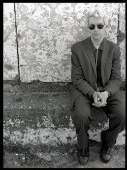 David Odlum sitting on a wall by David Cleary