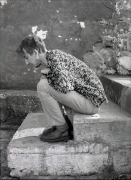 John Carney sitting on steps