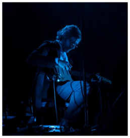 David Odlum on stage in blue light