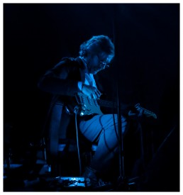 David Odlum on stage in blue light